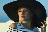 Beautiful woman in hat. On the Roof. Summer holidays. Blond girl — Stock Photo