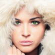 Young beautiful woman with fur. white fur hood. winter style.pretty girl — Stock Photo #45453339