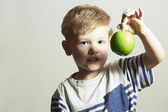 Child holds the apple.Little Handsome Boy with green apple. Health food. Fruits. Enjoy Meal — Stock Photo