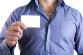 Man handing a blank business card — Stock Photo