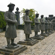 Stock Photo: Stone Mandarin Honor Guards at Tomb of Khai Dinh, Hue, Vietnam.
