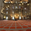 Stock Photo: Blue mosque interior with chandelies and carpet.
