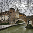 Ponte Fabricio and island Isola at the Tiber river, Rome, Italy. - Stock Photo