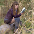 The girl with a book on the nature of — Stock Photo