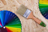 Color palette of paint and a brush — Stock Photo