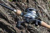Modern powerful fishing reel spinning — Stock Photo