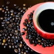 Stock Photo: Coffee beans and coffee cup