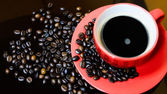 Coffee beans and coffee cup — Stock Photo