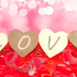 Four chocolate hearts with a LOVE message in them. — Stock Photo #19096015