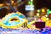 Carnival scene with drink in focus. — Stock Photo