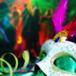 Carnival mask with party on the background. — Stock Photo