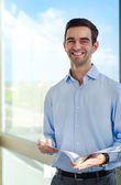 Successful young business men holding documents. — Stock Photo