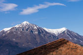 Roof superimposed on mountai — Stock Photo