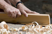 Hands of carpenter — Stock Photo