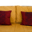 Sofa with two blue pillows — Stock Photo #28987875