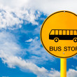 Bus stop sign and blue sky — Stock Photo