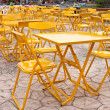Yellow tables and chairs outdoor place — Stock Photo #28989693