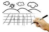 白い紙の上のフィールドと空の図面の手 — ストック写真