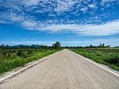 Asphalt road with blue sky — Stock Photo