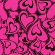 Seamless pattern with pink hearts — Stock Vector