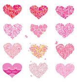 Set of beautiful floral and lacy hearts — Stock Vector