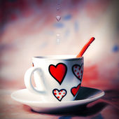 Cup with hearts — Stock Photo