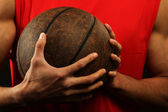Basketball player holding ball — Stock Photo