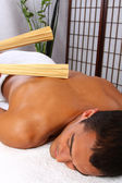Young man receiving massage — Stock Photo