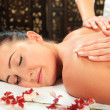 Stock Photo: Young woman receiving massage