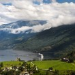 Geiranger fjord, Norway with cruise ship - Stock Photo
