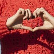 Heart shape made by hands of a young woman — Stock fotografie
