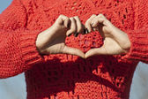 Heart shape made by hands of a young woman — Stock Photo