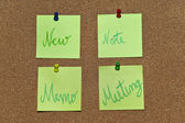 A collection of multicolored post it notes with different messages on a wooden background — Foto Stock