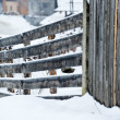 Wooden fence covered with snow — ストック写真