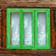Green window of a rustic old house with wooden walls — Stok fotoğraf