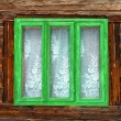 Green window of rustic old house with wooden walls — Stok Fotoğraf #21484457