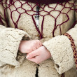 Close up of girl's hands dressed in traditional Romaniwear — Stock Photo #21484839