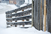 Wooden fence covered with snow — Stock Photo