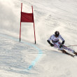 BRASOV ROMANIA - European youth Olympic - Winter festival 2013. Young ski racer during a slalom competition. — Stock Photo