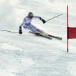 ブラショフのルーマニア - 欧州青年オリンピック - 冬の祭り 2013年。若いスキー レーサー スラローム競技中に — ストック写真