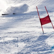 Photo: Young ski racer during slalom competition falling down