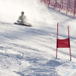 Stock Photo: BRASOV ROMANI- Europeyouth Olympic - Winter festival 2013. Young ski racer during slalom competition falling down