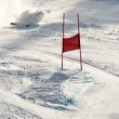 Stock Photo: Young ski racer during slalom competition falling down
