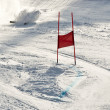 ストック写真: Young ski racer during slalom competition falling down
