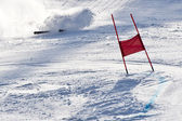 Young ski racer during a slalom competition falling down — Stok fotoğraf