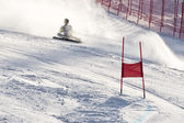 BRASOV ROMANIA - European youth Olympic - Winter festival 2013. Young ski racer during a slalom competition falling down — Foto de Stock