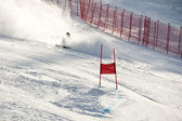 Young ski racer during a slalom competition falling down — Стоковое фото