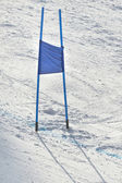Ski gates with blue flag — Stock Photo