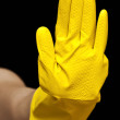 Hand with yellow rubber glove. Cleaning concept — Stok fotoğraf