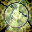 Dna with magnifying lens — Stockfoto